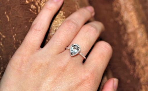 Pear shaped rose gold engagement ring with halo