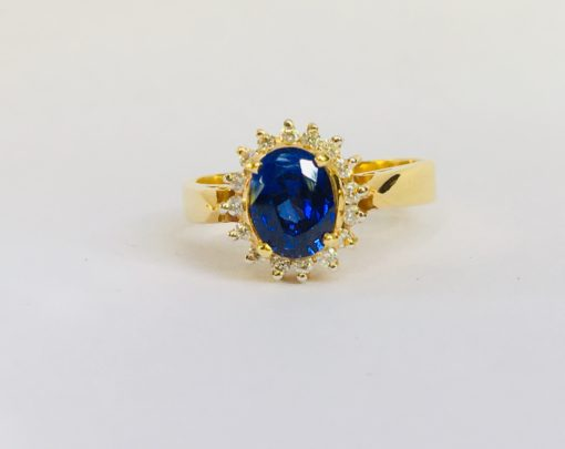 oval blue sapphire surrounded by diamonds